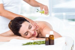 44769872 - smiling woman getting an aromatherapy treatment in a healthy spa